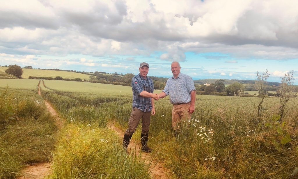 Photo: Richard Baines, North Yorkshire Turtle Dove Project Officer and farmer James Robinson on a farm where a new conservation plot was created this year following the discovery of a turtle dove on the farm last year.