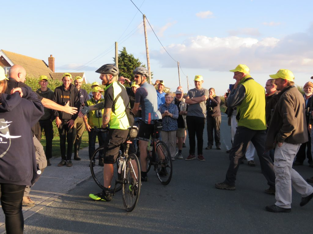 Photo: Jonny Rankin and Nick Moran arrive at the finish line in Kilnsea. Credit: Dawn Balmer.